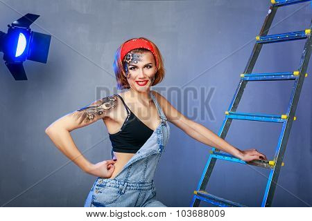 Girl Mechanic With Face Art On Site.