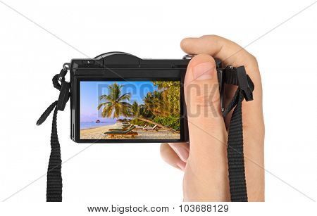 Hand with camera and Maldives beach photo (my photo) isolated on white background