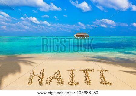 Word Haiti on beach - concept holiday background