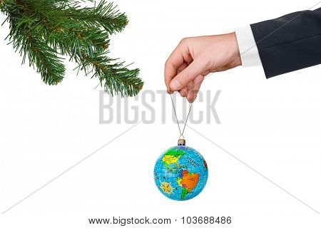 Hand with earth and Christmas tree  isolated on white background