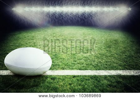 rugby ball against rugby pitch