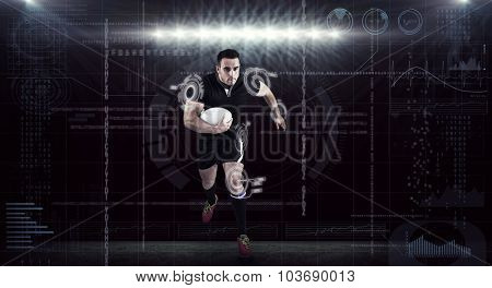 Rugby player running with the ball against spotlights