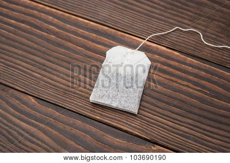 Top View Teabag On A Wooden Background