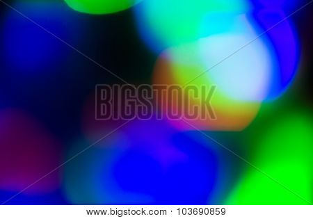 holidays, illumination and electricity concept - colorful bright night lights over black background