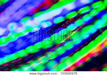 holidays, illumination and electricity concept - colorful bright night lights stream over black background