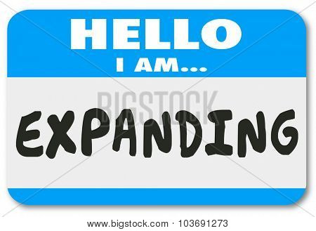 Hello I am Expanding words on a blue nametag or sticker to illustrate growth or increased success in business, career, job or life