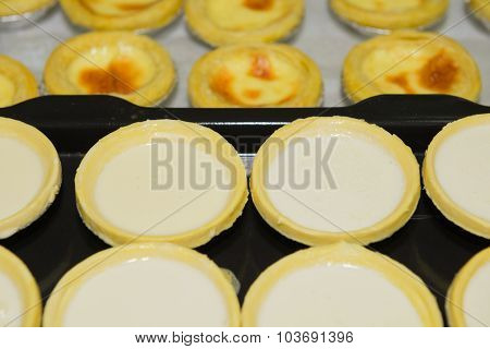 Unbaked And Baked Egg Tarts