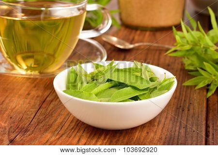 Lemon Verbena Leaves And Tea On Table.