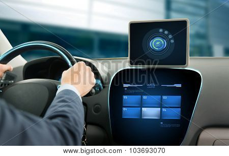 transport, business trip, technology and people concept - close up of young man with tablet pc computer driving car and using eco system mode