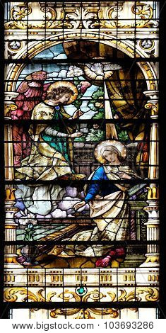 ZAGREB, CROATIA - MAY 28: Annunciation of the Virgin Mary, stained glass window in the Basilica of the Sacred Heart of Jesus in Zagreb, Croatia on May 28, 2015