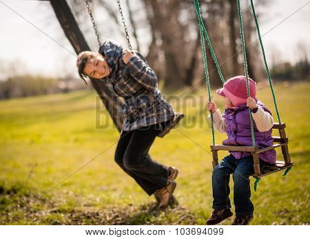 Swinging together - mother and baby