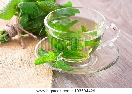 Cup Of Mint Tea And A Bunch Of Mint