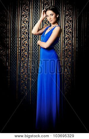 Full length portrait of a beautiful elegant lady in vintage interior. Fashion shot.