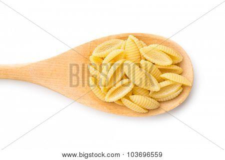 uncooked italian pasta in wooden spoon