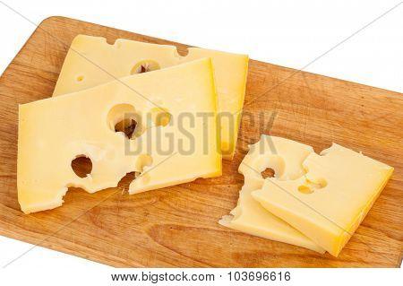 Cheese on kitchen plank