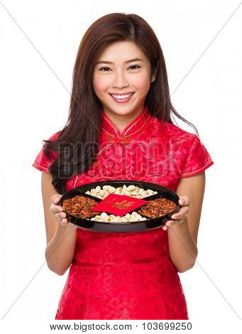 Young Chinese woman hold with snack tray