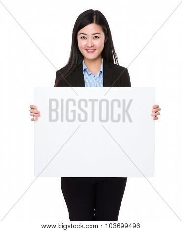 Young businesswoman show with the white banner