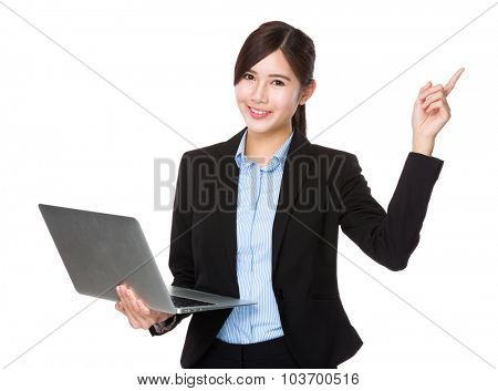 Asian businesswoman use of the laptop computer and finger point up