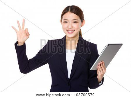 Businesswoman hold with tablet pc and ok sign gesture