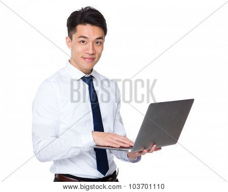 Businessman use of the notebook computre