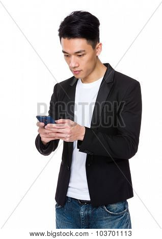 Young businessman read on the mobile phone