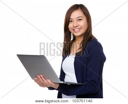 Asian young woman use of the laptop computer