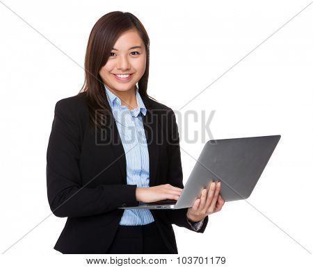 Young businesswoman use of the notebook computer