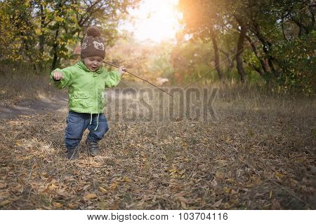 A Boy With A Stick.