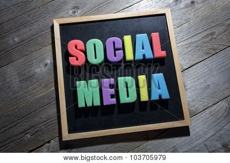 Social media word from letters on a blackboard sign