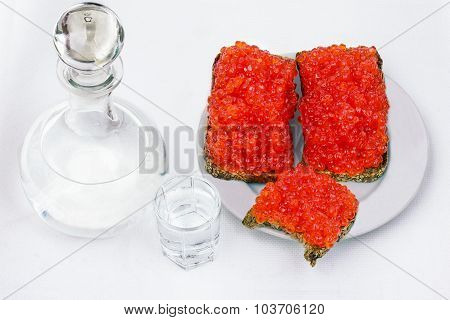 Vodka In A Decanter, And Sandwiches With Red Caviar