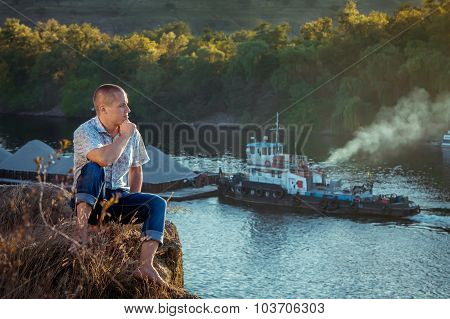 Man sitting on the cliff