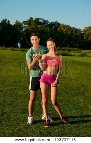 Guy and  girl take care of their figure.