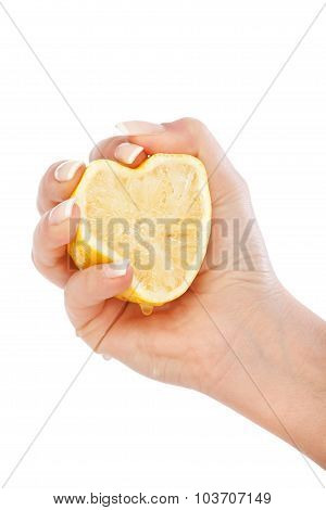 Young Woman Squeezing Lemon