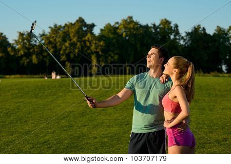 Guy and a girl make selfie on the golf course.