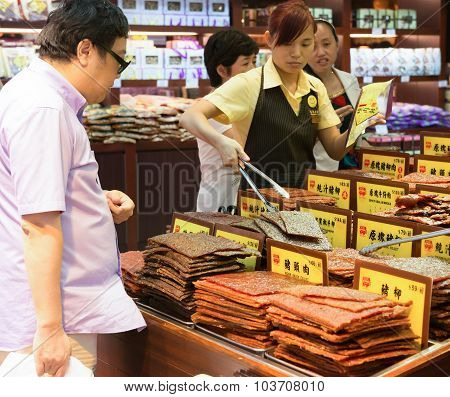 Macao - June 25, 2015:visitors Buying Beef Jerky At Macao Historic Center On June 25, 2015.the Histo
