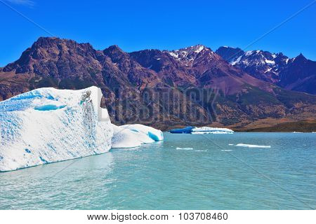 Ice and sun Patagonia, Argentina. Excursion on the tourist boat on Lake Viedma. White and blue icebergs floating near the ship broadside