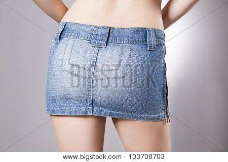 Woman In Jeans Skirt Close Up. Beautiful Female Hips And Buttocks