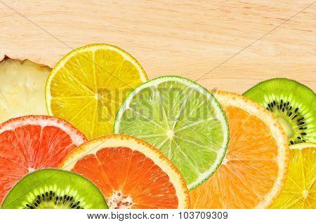 Beautiful Citrus Fruits Of Lemon, Orange, Grapefruit, Lime On Wooden Texture Close-up