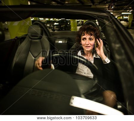 Business woman calling and driving