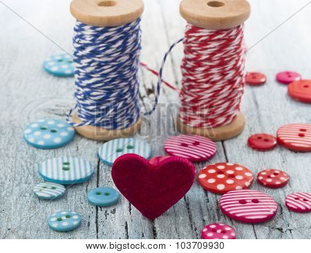 Symbol of love, Blue and Red bobbins connected