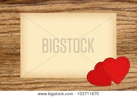 Valentines Day Cloth Hearts With With Blank Paper Against An Old Wood Background