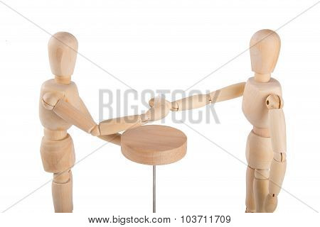 Wooden Puppet Couple Having A Drink