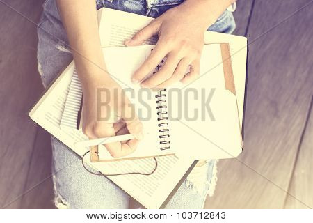Girl Sitting On The Floor And Wrote In A Diary