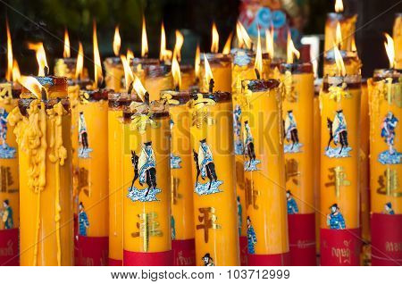 Burning Candles At A Chinese Temple