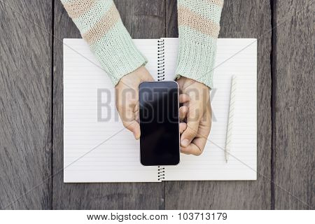 Girl Hands With Smartphone And Blank Diary With Pencil
