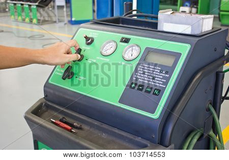 Man's Hand Working With Nitrogen Tire Filling System Machine.