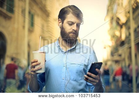 Long-bearded man with smartphone