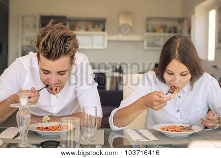 Teenagers eating together
