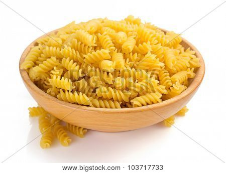 fusilli pasta in bowl isolated on white background