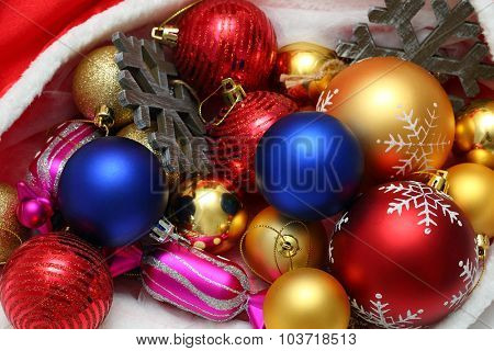 Bright christmas balls, toys in red bag